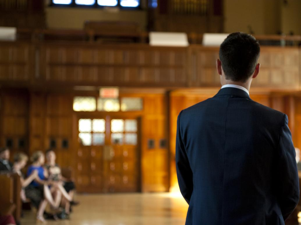 Groom waits for bride at Loyola Chapel, Montreal