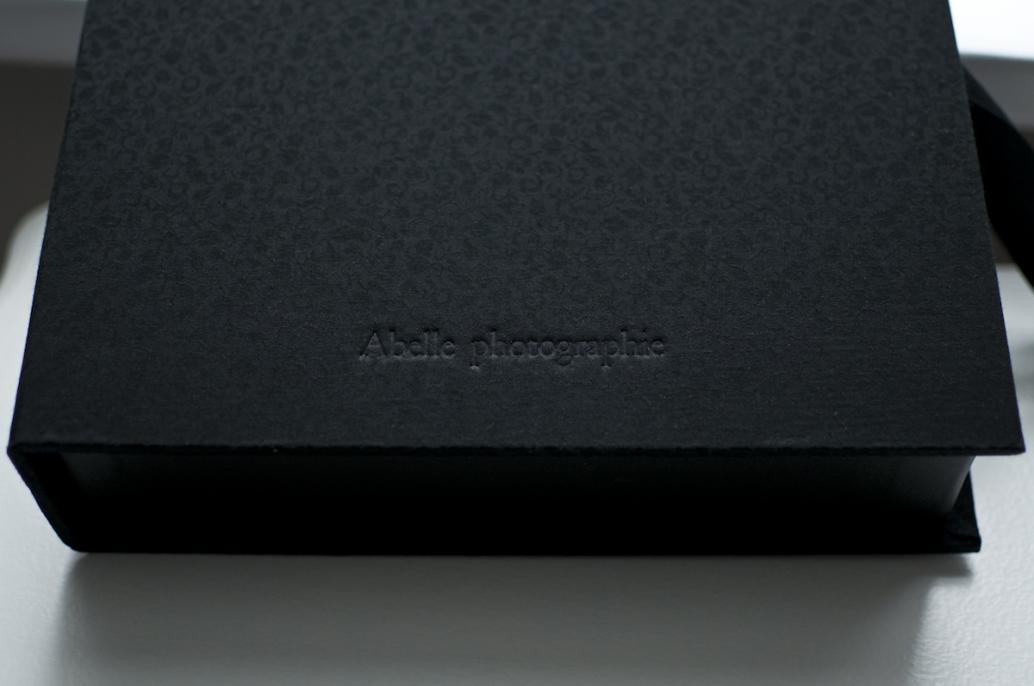 Optional embossing shown on black brocade cover.