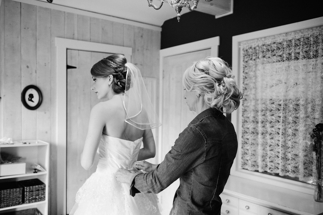 bride getting ready with mother